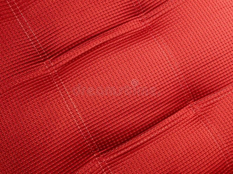 Abstrakte rote Textilhintergrundnahaufnahme, Tuch, stockfoto
