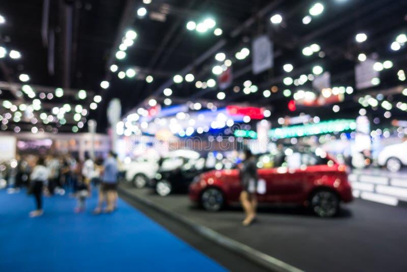 Abstrakte Unschärfe und defocused Auto und Automobilausstellung stellen dar stockfoto