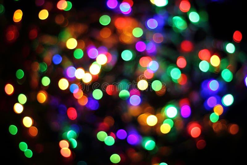 Abstrakte Weihnachtsfarbe beleuchtet Hintergrund lizenzfreie stockfotografie