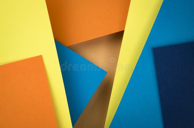 Abstrakte Zusammensetzung von blauen und orange Papieren lizenzfreies stockbild