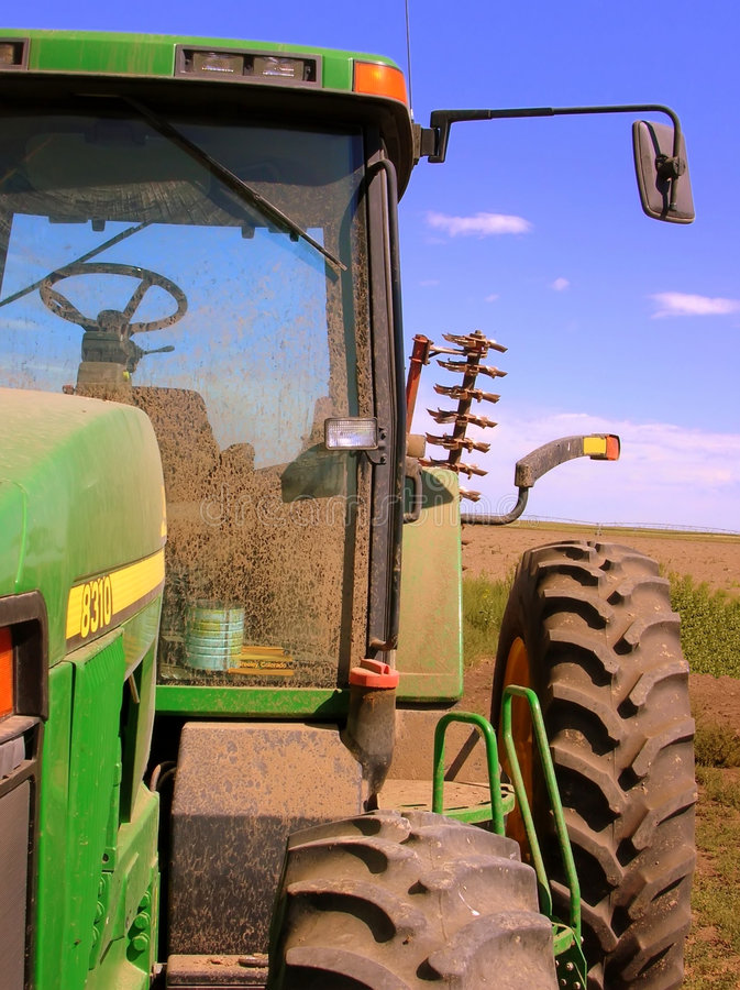 Abstrakter Bauernhof-Traktor stockfoto
