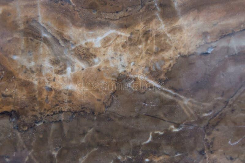 Abstrakter beige brauner Marmorbeschaffenheitshintergrund Naturstein-Muster lizenzfreie stockbilder