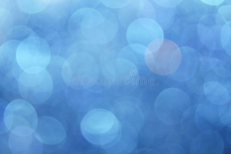 Abstrakter blauer bokeh Hintergrund stockbilder