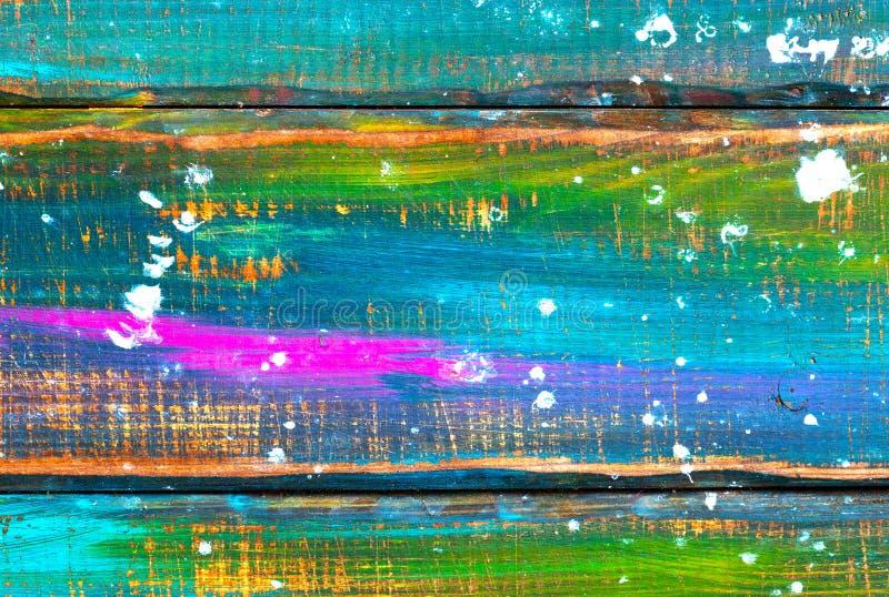 Abstrakter bunter Hintergrund Hölzerne Bretter umfasst mit mehrfarbiger Farbe Heller bunter Hintergrund lizenzfreie stockfotos