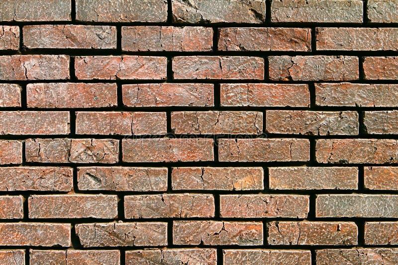 Abstrakter Fotohintergrund der alten netten natürlichen braunen Backsteinmauer lizenzfreies stockbild