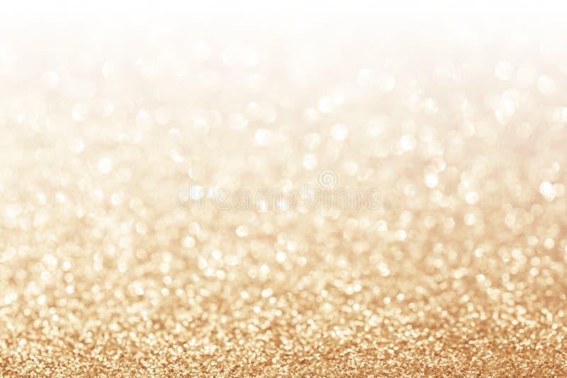 Abstrakter Funkelngoldhintergrund stockbild