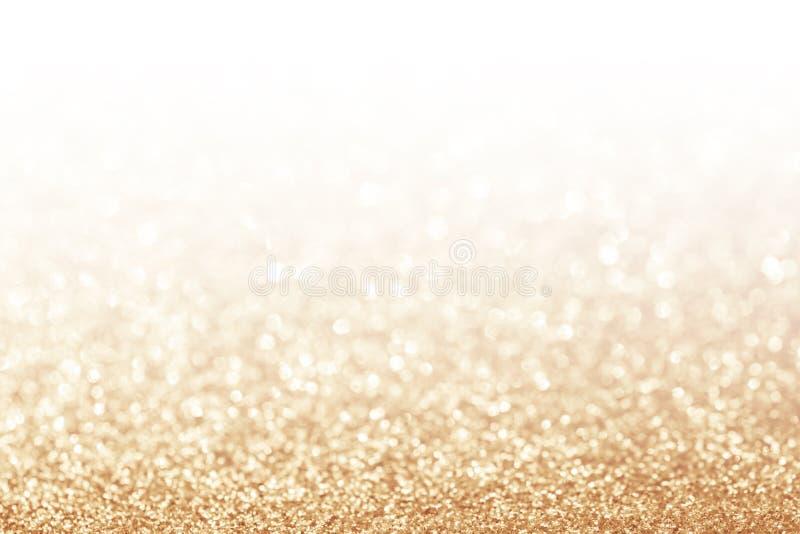 Abstrakter Funkelngoldhintergrund stockfotos