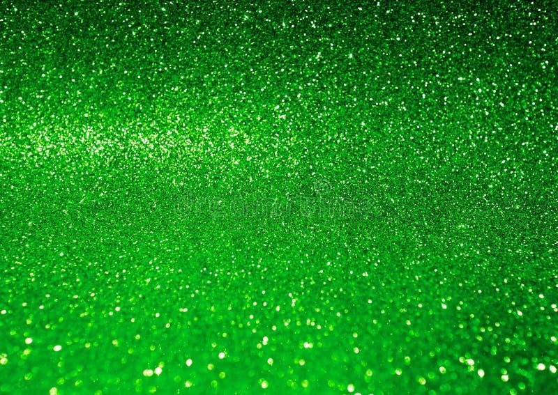 Abstrakter glänzender grüner Funkelnhintergrund stockfotos