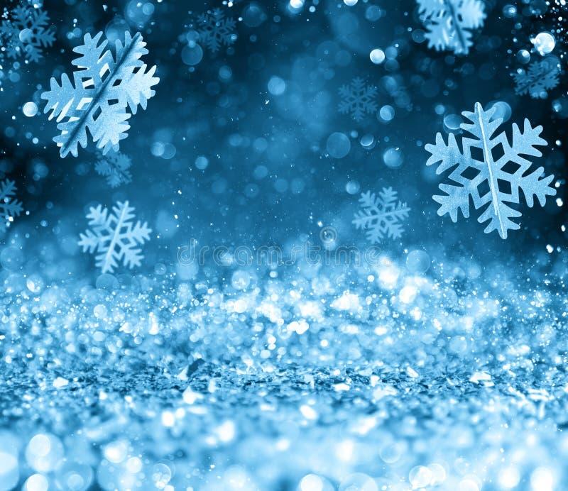Abstrakter glühender Weihnachtsblauer Hintergrund mit Schneeflocken stockfotografie