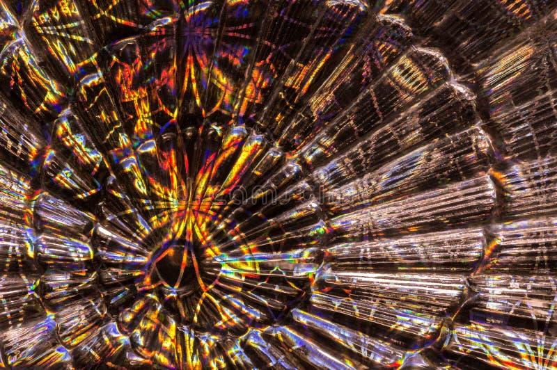 Abstrakter Glashintergrund mit buntem Papier Hintergrund in Form eines Fans stockfoto