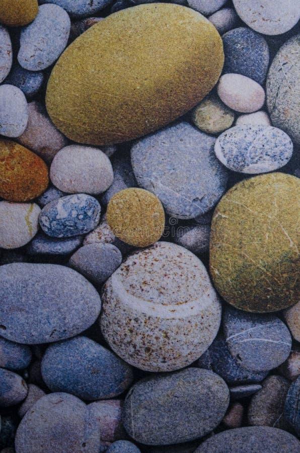 Abstrakter glatter runder Kieselseebeschaffenheitshintergrund stockbilder