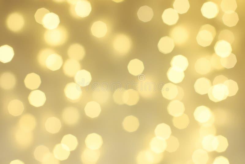 Abstrakter Gold-Scheinhintergrund, defocused Weihnachten-bokeh lizenzfreie stockfotos