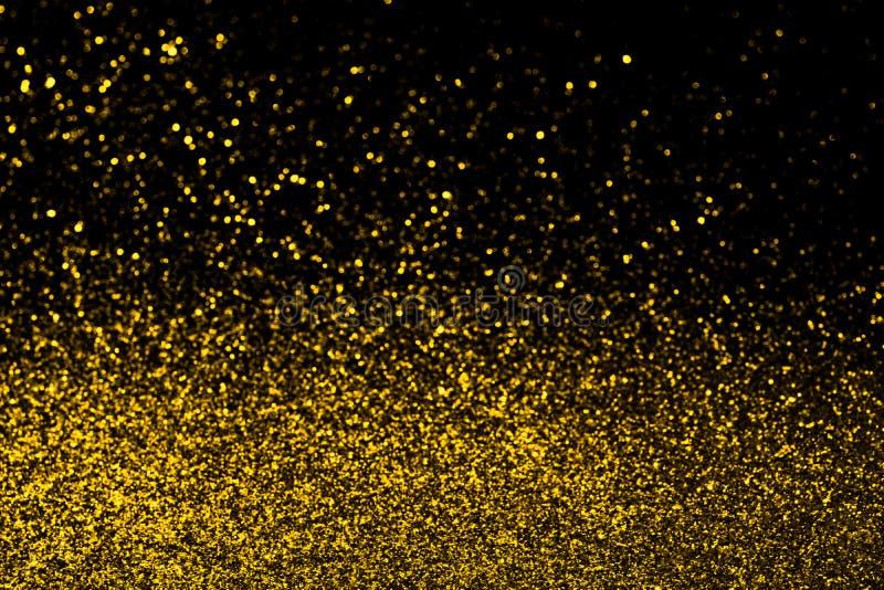 Abstrakter Goldfunkelnhintergrund lizenzfreie stockbilder