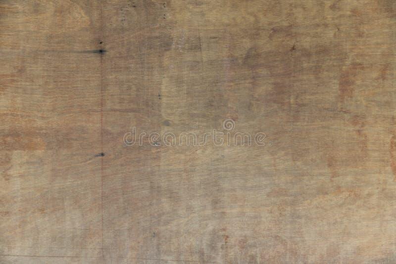 Abstrakter Hintergrund der alten Sperrholzbeschaffenheit mit Fleck stockfotos