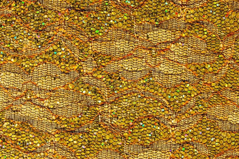 Abstrakter Hintergrund der Goldspitzes und -Paillette lizenzfreies stockfoto