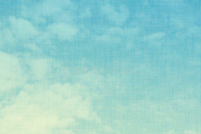 Abstrakter Hintergrund des blauen Himmels der Steigung auf Weinlesegewebebeschaffenheit lizenzfreie stockfotos