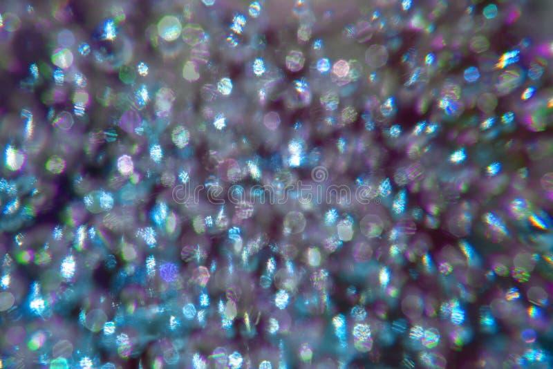 Abstrakter Hintergrund des purpurroten bokeh mit polarisierter Beugung lizenzfreies stockfoto