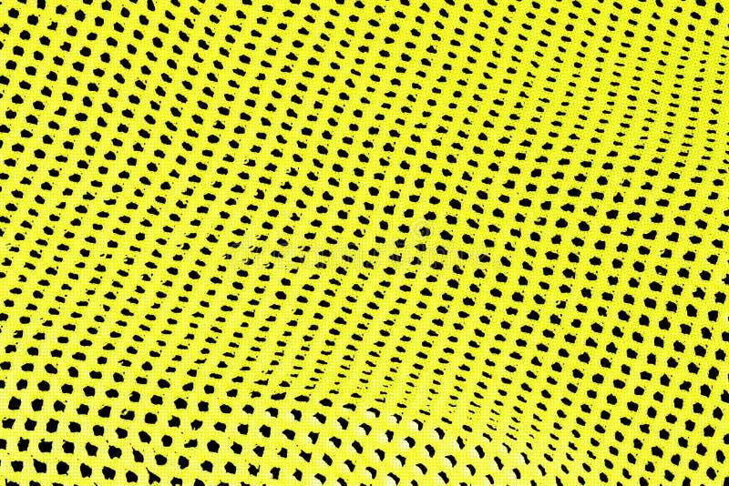 Abstrakter Hintergrund von gelben und schwarzen Löchern in der Reihe lizenzfreie stockfotografie
