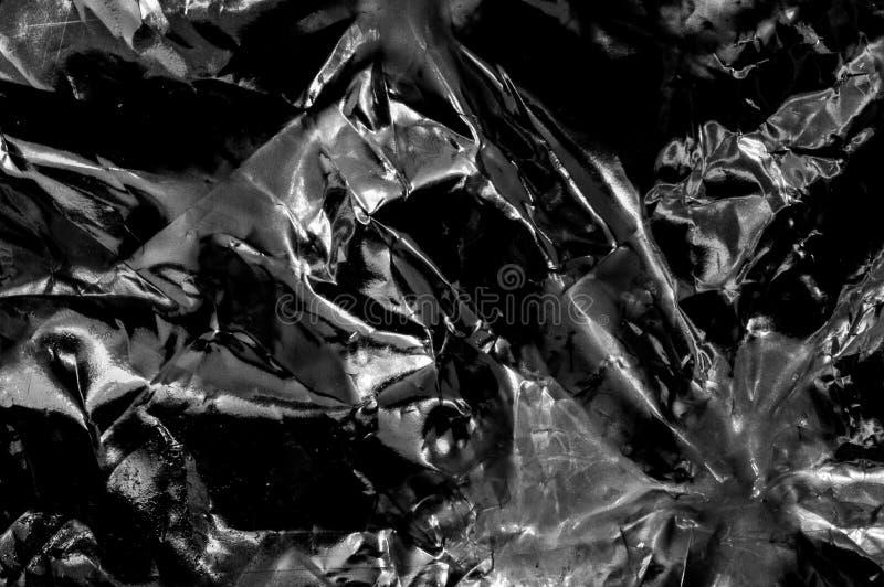 Abstrakter Metallhintergrund im Schwarzen und in siler Farbe stockfotografie