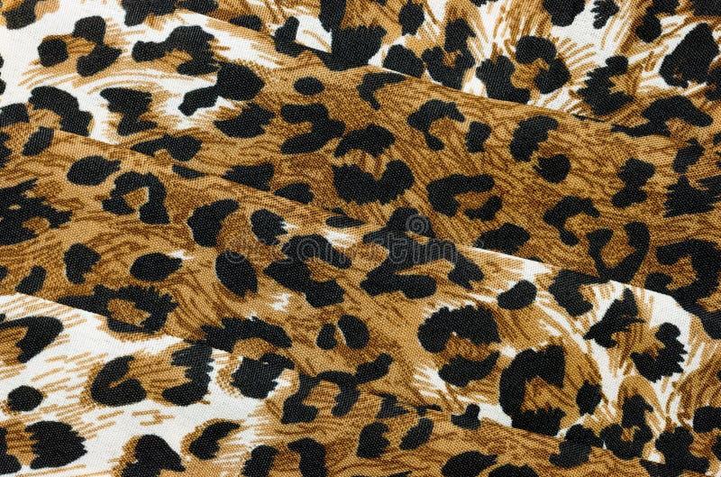 Abstrakter strukturierter Hintergrund des gefalteten Tierdruckgewebes stockbilder