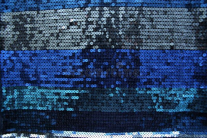 Abstraktes Blau spangles Hintergrund stockfotos