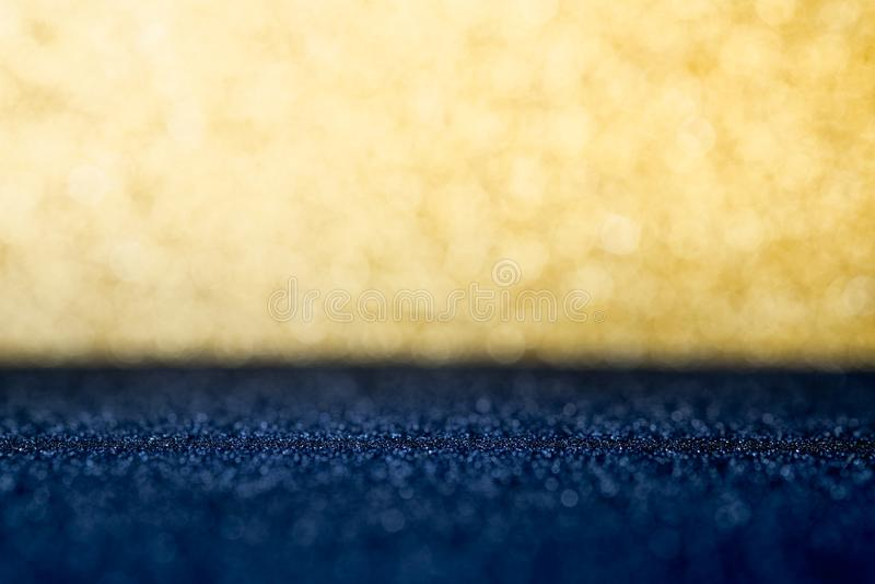 Abstraktes Gold und dunkelblaues funkelndes bokeh Wand und Boden backg stockbild