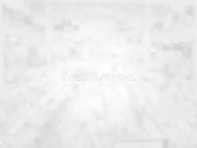 Abstraktes helles weißes bokeh auf weißem und grauem Hintergrund lizenzfreie stockfotos