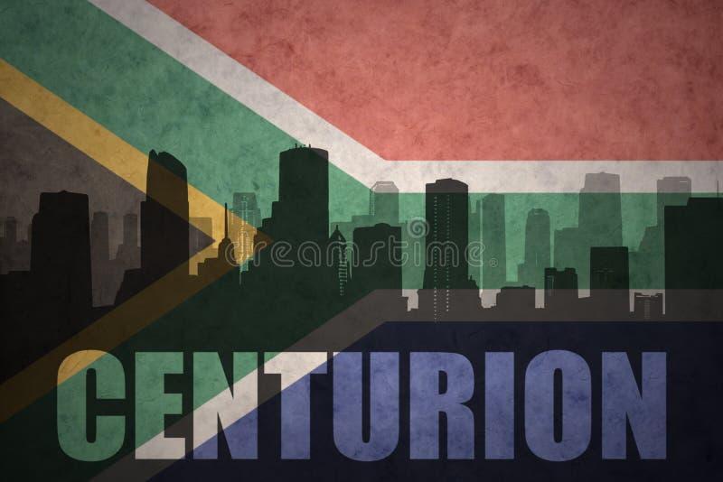 Abstraktes Schattenbild der Stadt mit Text Befehlshaber an der Weinlesesüdafrika-Flagge vektor abbildung