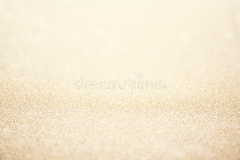 Abstraktes Unschärfegoldfunkelnweihnachtsereignisfeier-Karte desi stockfotos