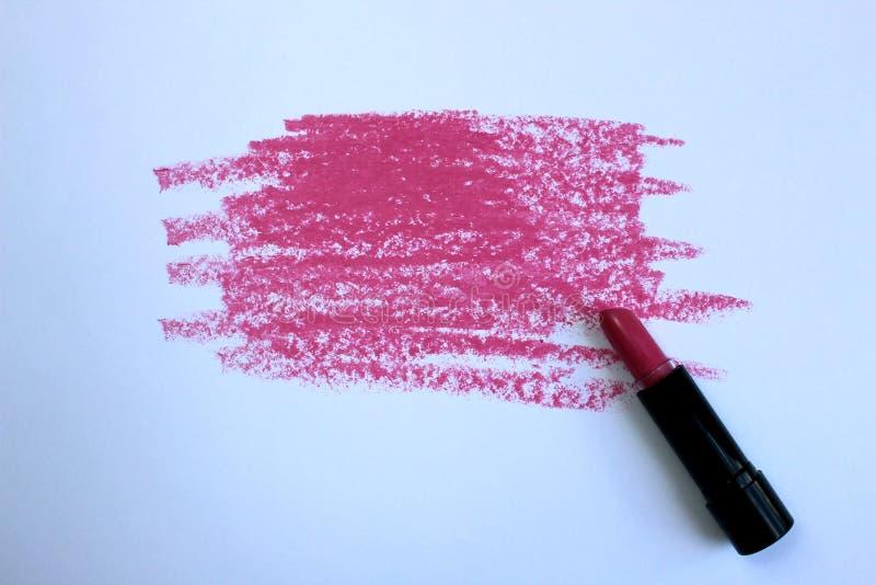 Abstrich des rosa Lippenstifts lokalisiert auf wei?em Hintergrund stockfotos