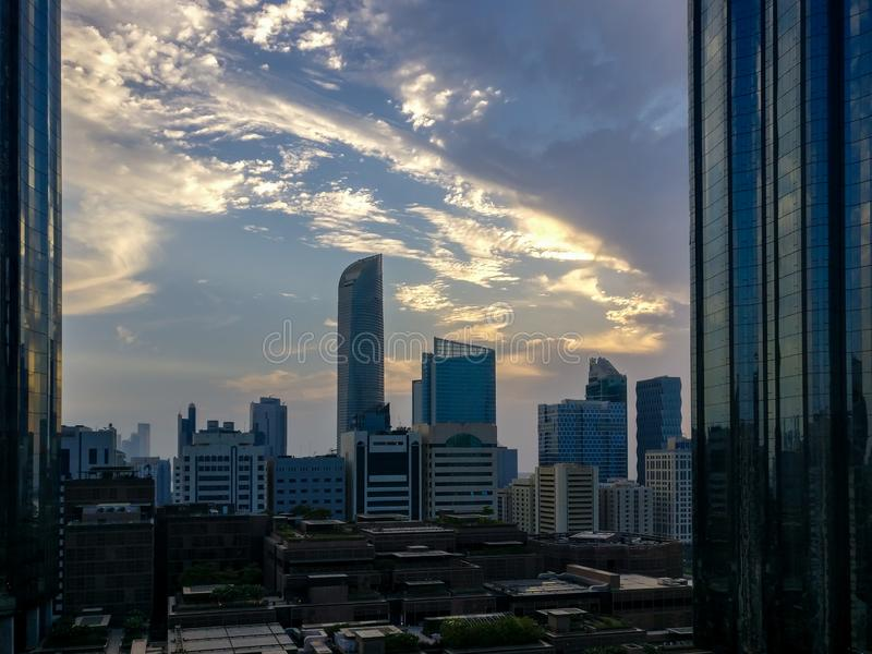 Abu Dhabi city epic clouds and World Trade Center Towers.  stock photography