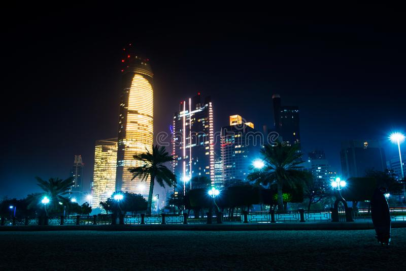 Abu Dhabi cityscape view from the city beach at night stock photography