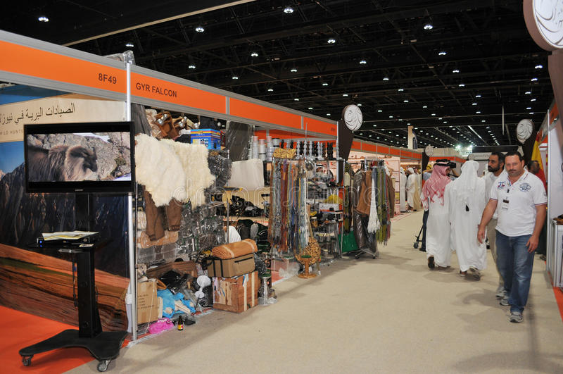 Abu Dhabi International Hunting and Equestrian Exhibition (ADIHEX). Peoples walking at Abu Dhabi International Hunting and Equestrian Exhibition (ADIHEX) 2013 in stock photography