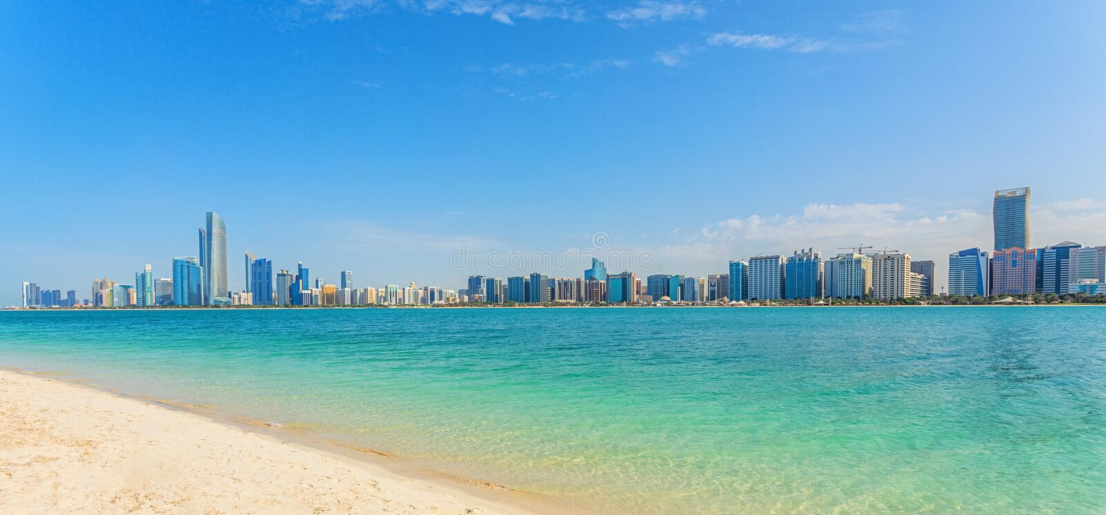 Abu Dhabi Skyline with water, skyscraper and beach, panoramic view stock photos