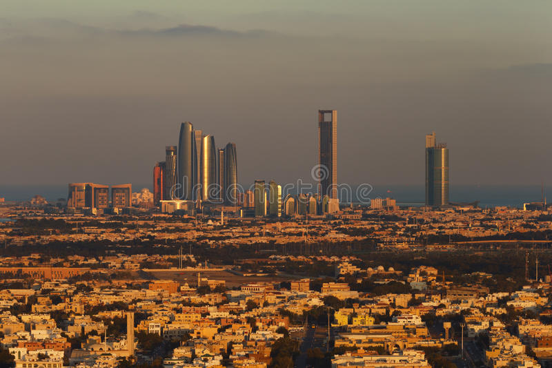 Abu Dhabi, UAE at dawn, showing the Corniche and Etihad Towers royalty free stock images