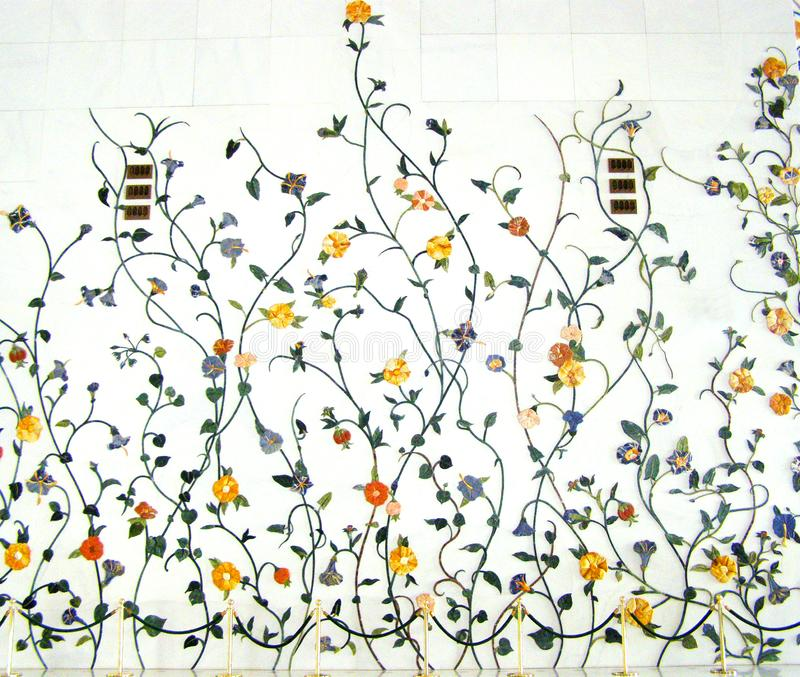 ABU DHABI, UAE - SEPTEMBER 20 th 2011: Marble flower form wall decorated inside in Sheikh Zayed Grand Mosque stock photos