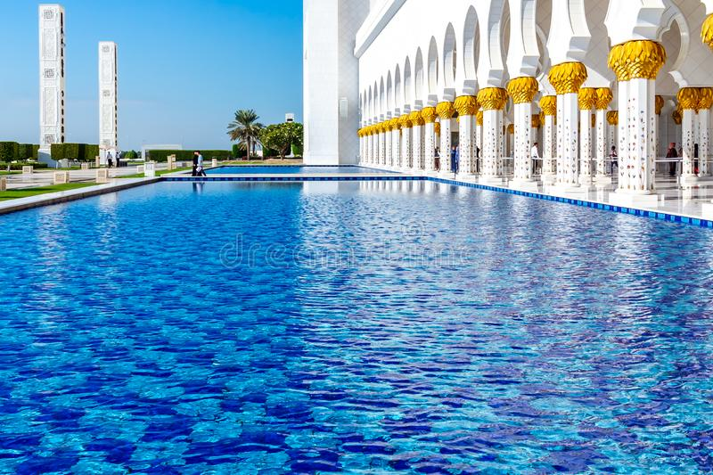 Abu Dhabi, United Arab Emirates - December 13, 2018: decorative water pools in front of the Grand Mosque royalty free stock image
