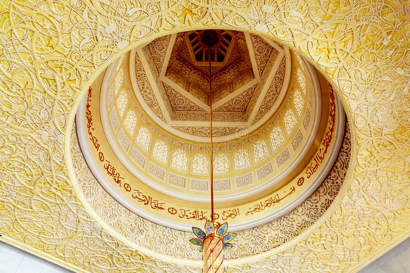 Abu Dhabi, United Arab Emirates - December 13, 2018: Interior of the Grand Mosque in Abu Dhabi - the ceiling, a place for stock photo
