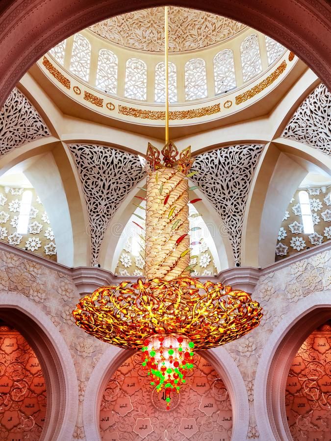 Abu Dhabi, United Arab Emirates - December 13, 2018: Interior of the Grand Mosque in Abu Dhabi - chandelier royalty free stock image