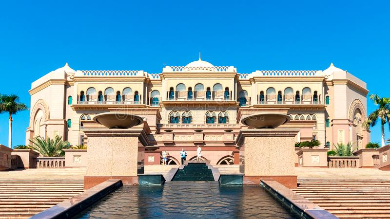 Abu Dhabi, United Arab Emirates - December 13, 2018: Staircase with a stream and the facade of the famous Palace of the Emirates royalty free stock photo