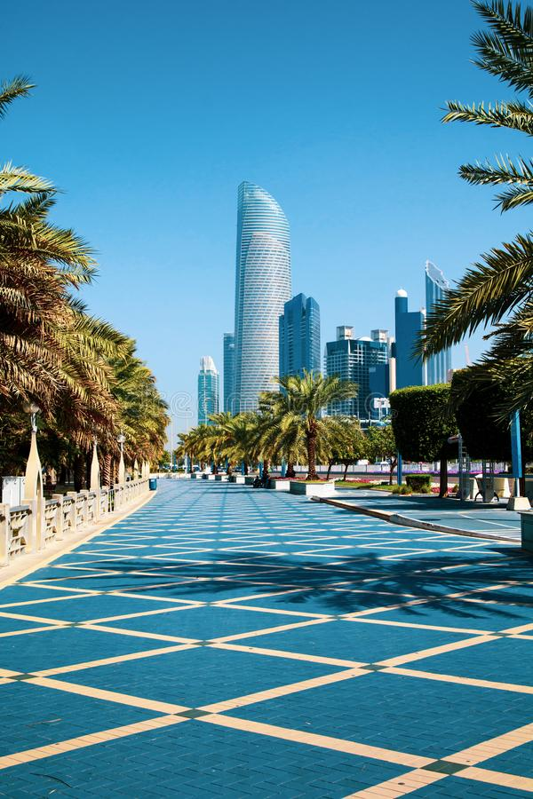 ABU DHABI, UNITED ARAB EMIRATES - JANUARY 27, 2017: Abu Dhabi Co. Rniche walking area with landmark view of modern buildings on Corniche road, UAE, city royalty free stock photography