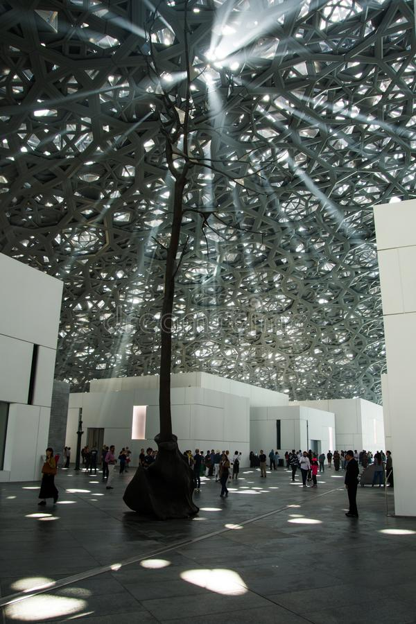 ABU DHABI, UNITED ARAB EMIRATES - JANUARY 26, 2018: Lights passing through roof and ceiling of Louvre Abu Dhabi presenting Rain o. F Light design feature stock image