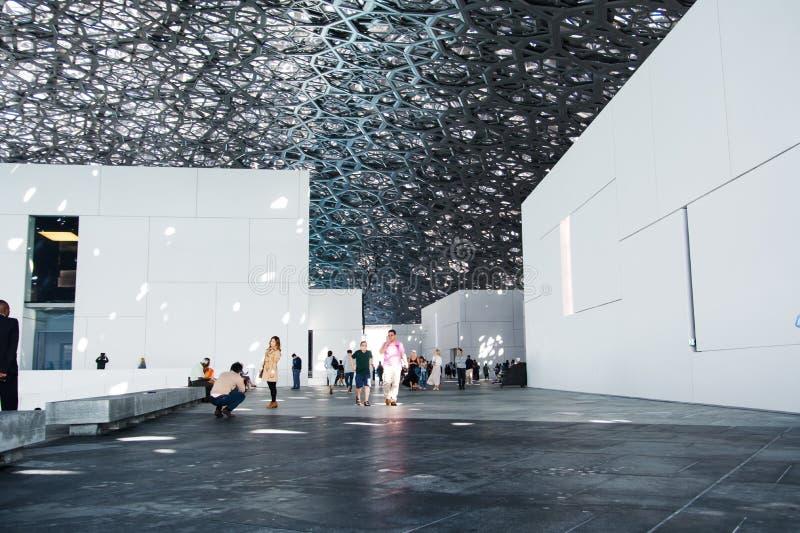 ABU DHABI, UNITED ARAB EMIRATES - JANUARY 26, 2018: Louvre Abu D. Habi modern hall with Rain of Light roof design stock photos