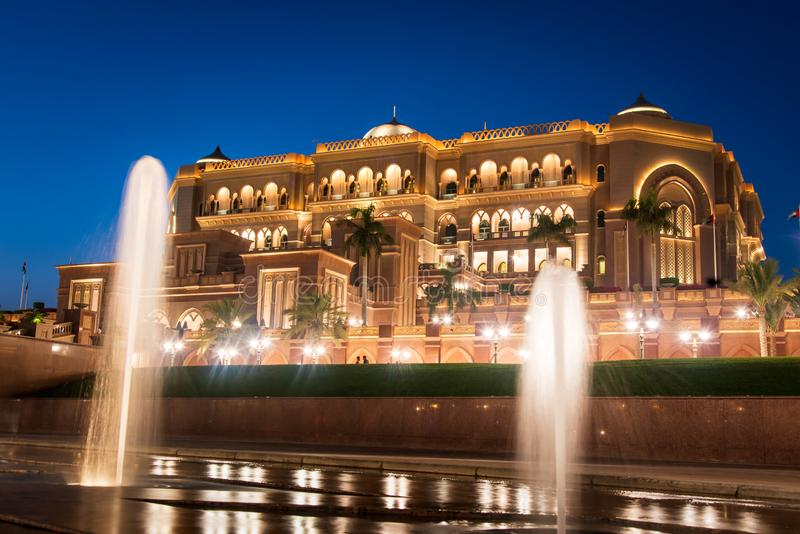 Abu Dhabi, United Arab Emirates - November 1, 2019: Emirates palace in Abu dhabi reflected on the ground level fountain. At blue hour, uae, landmark, night stock images