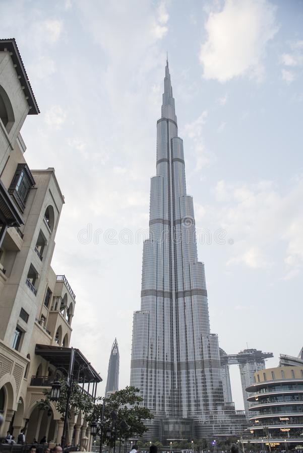 Over the high-rise skyscraper Burj Khalifa in sunny weather stock image