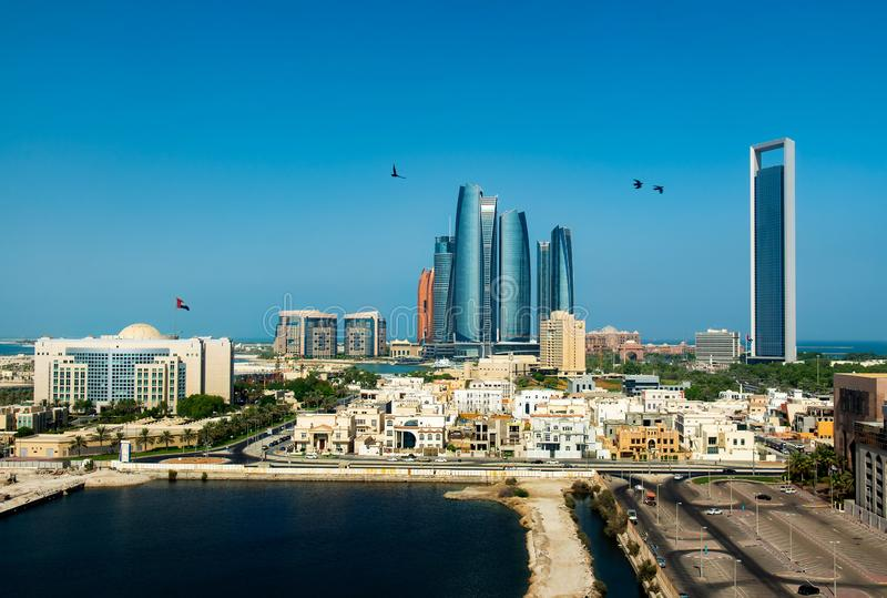 Abu Dhabi, United Arab Emirates - September 19, 2019: Abu Dhabi skyline view of the downtown buildings rising over the water. Abu Dhabi, United Arab Emirates stock image