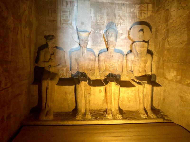 Abu Simbel central chamber around Sun festival. Two times a year the central chamber in Abu Simbel lights up. Then Ramses, Ra en Amun light up, only Ptah, the royalty free stock photography