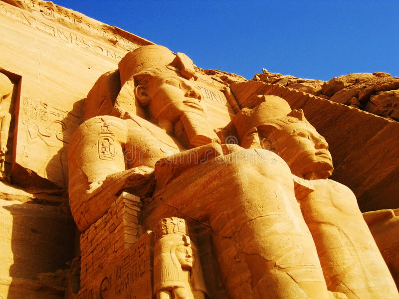 Abu Simbel Temple. Abu Simbel is an archaeological site comprising two massive rock temples in Nubia, southern Egypt on the western bank of Lake Nasser about 290 royalty free stock photo