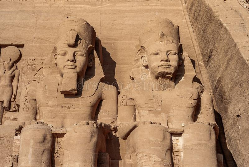 Abu Simbel - Two Statues of Ramesses II on the Great Temple. Abu Simbel - Two Colossal Statues of Pharaoh Ramesses II on the Great Temple in Egypt royalty free stock images
