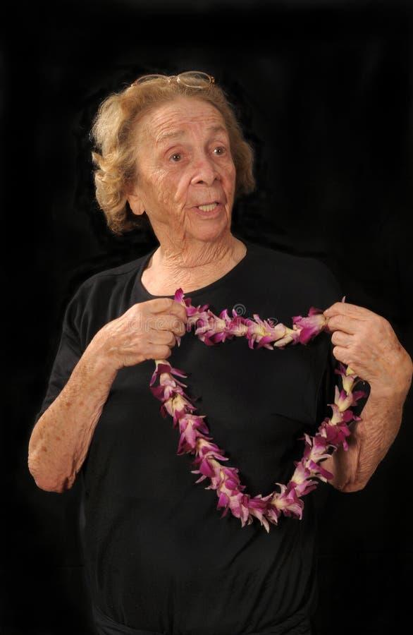 Abuela con los leus foto de archivo